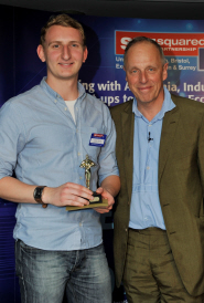 FoodCycle's Coordinator Adam Smith, left, receives the Best Social Enterprise Award from Simon Woodroffe