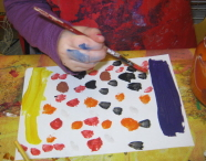 A child from St Werburgh's Park Nursery School and Children's Centre tries their hand at painting for the exhibition