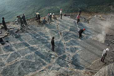 Image of the Luoping footprint site under excavation. Students and farmers help to clear the Shangshikan footprint site in summer, 2009, prior to photography and mapping