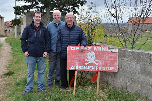 Image of Dr Oliver Payton and Dr John Day with Sir Bobby Charlton on a visit to mined areas in Croatia