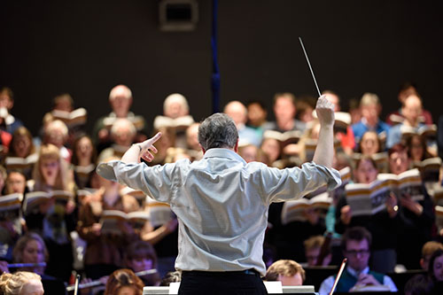 Image of Professor John Pickard conducting the Bristol University Symphony Orchestra