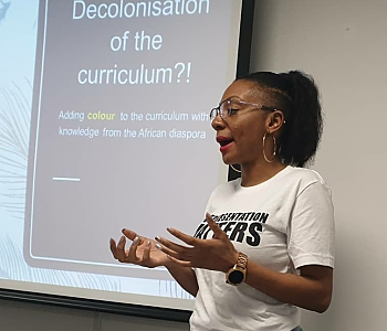 Aisha Thomas, Founder of Representation Matters, giving a talk 'Decolonising the curriculum'